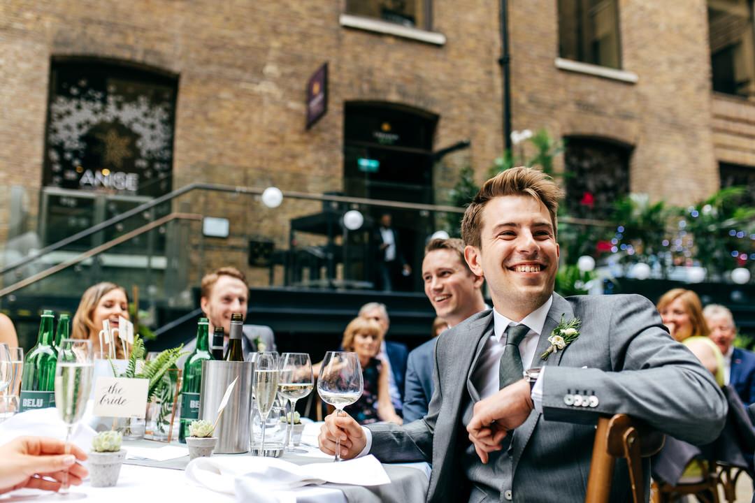 groom-laughing-devonshire-terrace-wedding