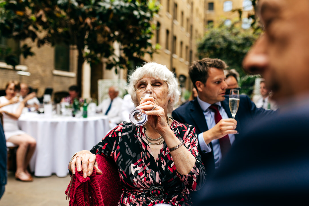 older-lady-guest-drinking-champagne