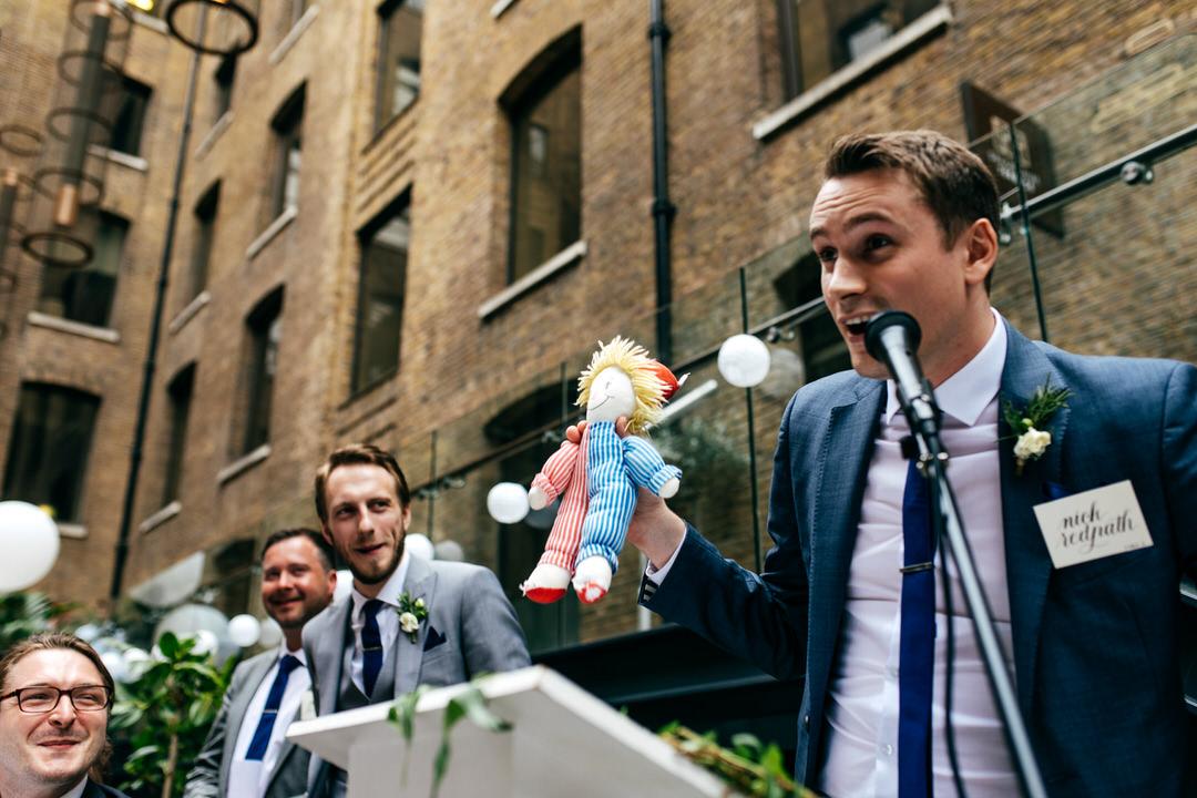 best-man-holds-up-spech-prop-london-wedding-photographer