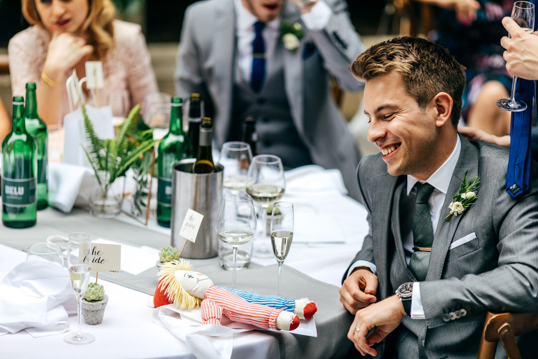groom-laughing-speeches-jewish-wedding-photographer
