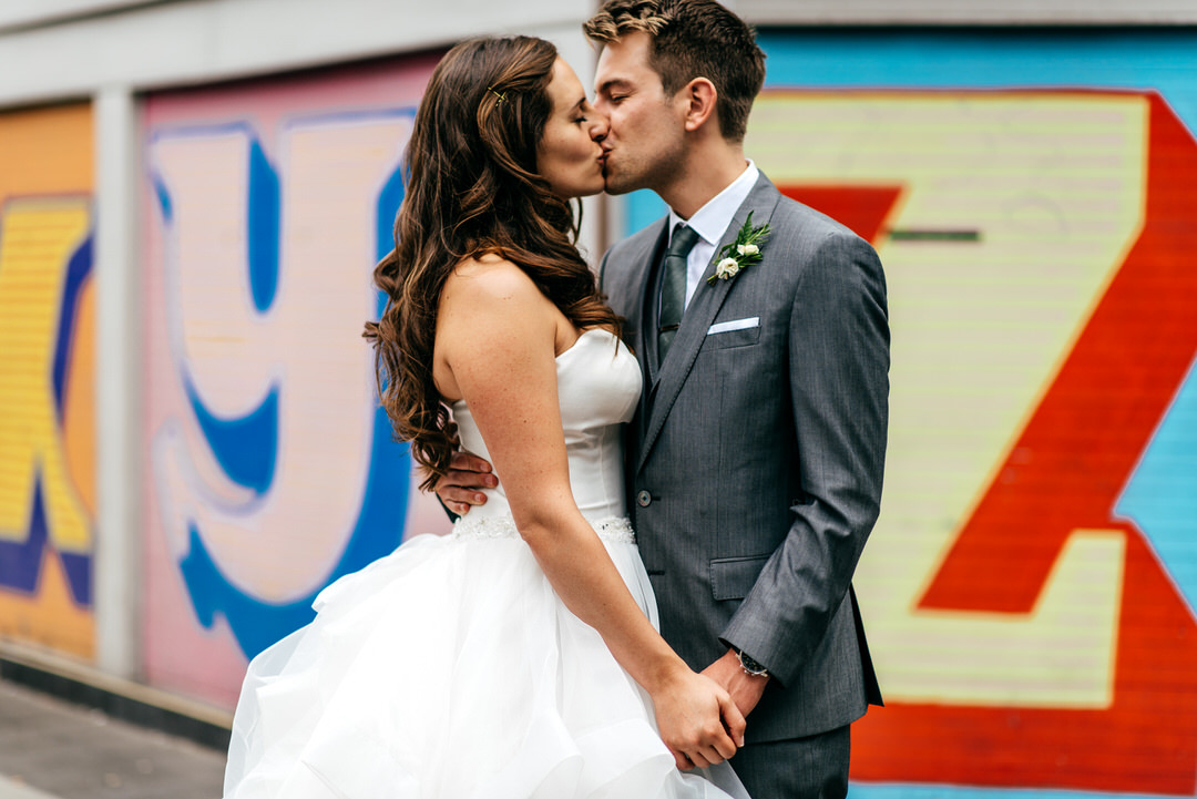 couple-kiss-with-urban-london-backdrop-devonshire-terrace-wedding