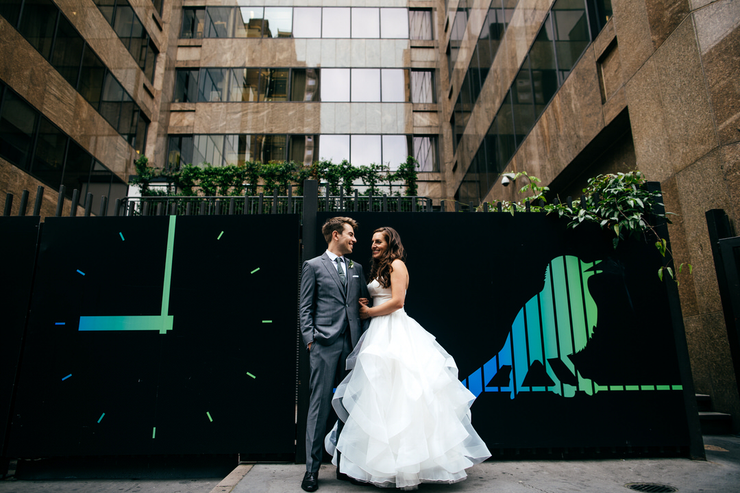 couple-standing-together-urban-london-bird-backdrop