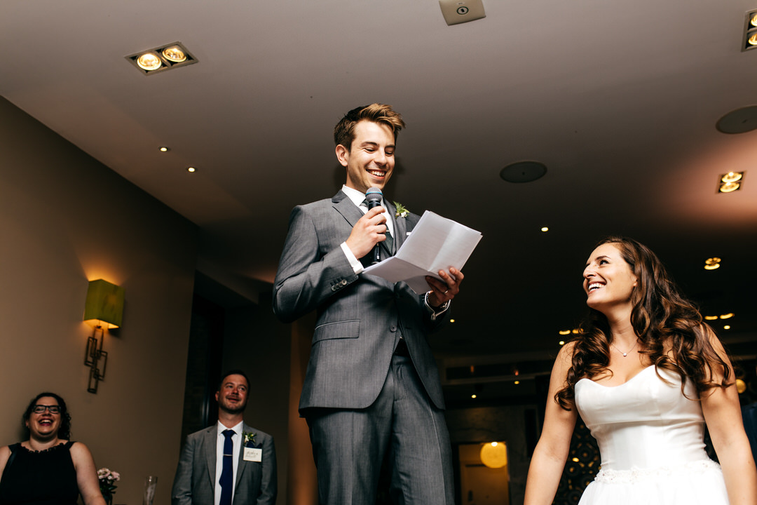 bride0-watches-groom-deliver-speech-sttod-upon-chair-jordanna-marston-photography