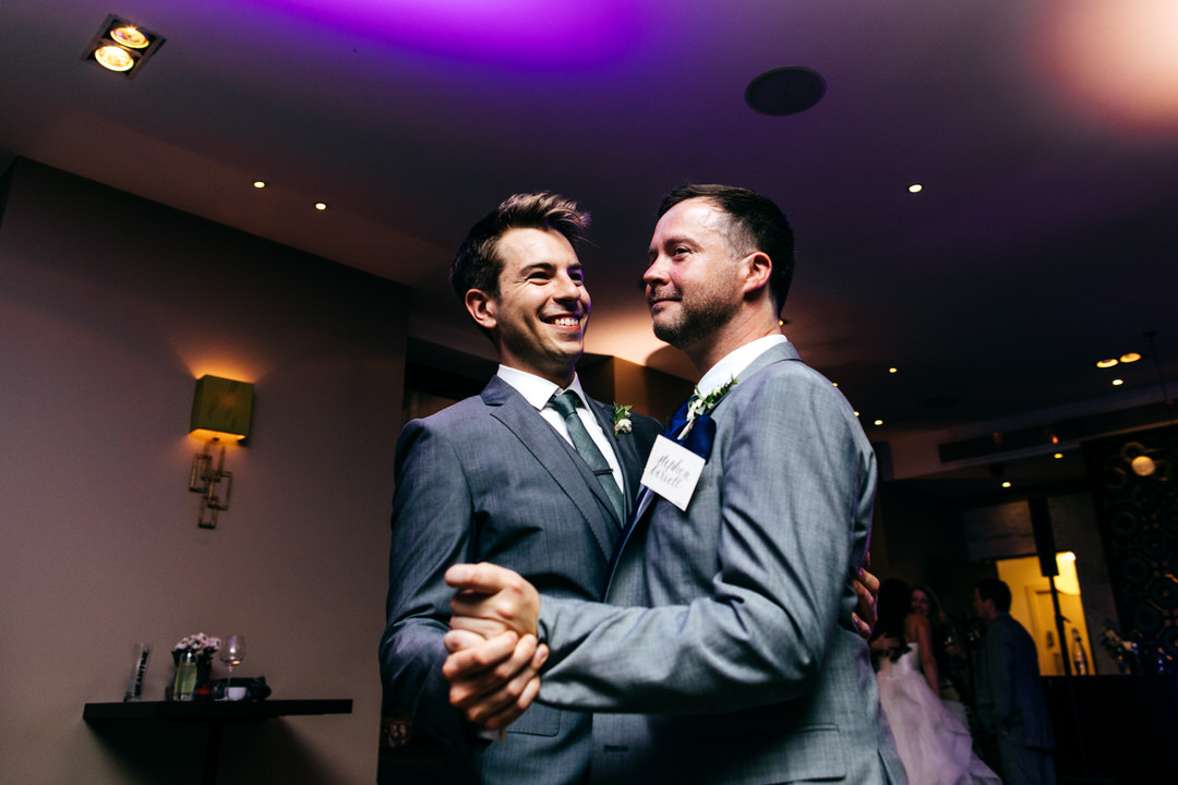 groom-dances-with-best-man-london-wedding-photographer